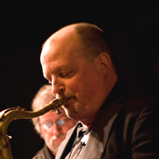 Mike West playing saxophone